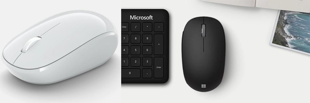 Die Microsoft Bluetooth® Mouse in Gletscher und die Microsoft Bluetooth® Mouse in Mattschwarz zwischen einer Tastatur und einem Bild