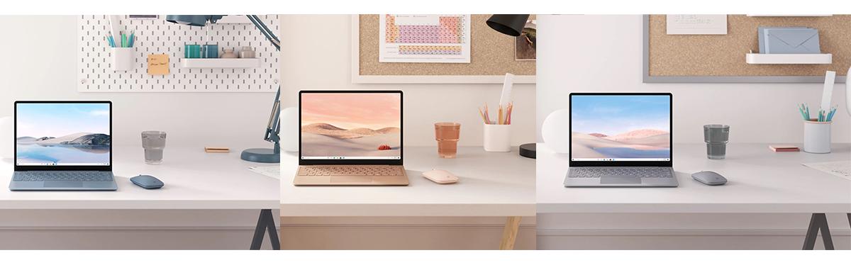 Drei Modelle des Surface Laptop Go in den Farben Eisblau, Sandstein und Platin, jeweils auf einem Schreibtisch